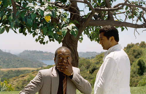 In this film image released by Paramount Pictures, Eddie Murphy, left, and Cliff Curtis are shown in a scene from