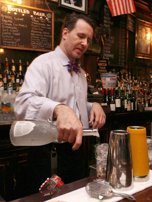 Doug Quinn pours a drink as he works at the bar at P.J. Clarke's Thursday, March 8, 2012 in New York. (AP Photo/Tina Fineberg)