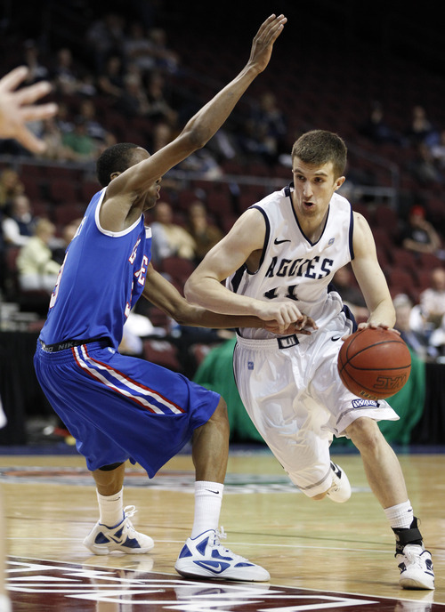 Eric Jamison  |  The Associated Press Utah State guard Adam Thoseby (11) drives past Louisiana Tech's Raheem Appleby (3) during an NCAA college basketball game in the Western Athletic Conference men's tournament Thursday, at Orleans Arena in Las Vegas. The Aggies lost, 72-70.
