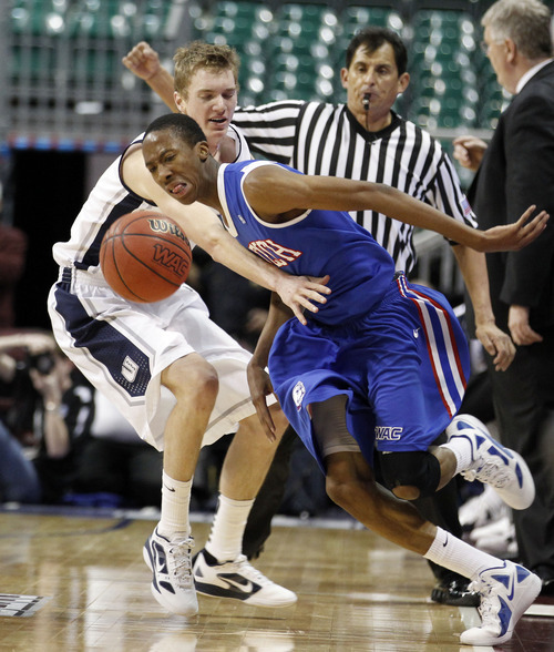 Louisiana Tech guard Raheem Appleby (3) is fouled by Utah State forward Danny Berger (12) during their NCAA college basketball game in the Western Athletic Conference tournament Thursday, March 8, 2012, at The Orleans Arena in Las Vegas. Louisiana Tech defeated Utah State 72-70. (AP Photo/Eric Jamison)