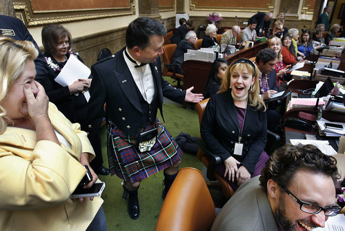 Scott Sommerdorf  |  The Salt Lake Tribune              Rep. Stephen Sandstrom shows off his kilt to Rep. Jennifer Seelig, D-Salt Lake, in the Utah House of Representatives Thursday.