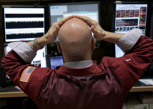 (AP Photo/Seth Wenig) Investors' apparent skittishness has led to less trading. About 3.9 billion shares of stock have traded on an average day this year at the New York Stock Exchange, down a third from three years ago.