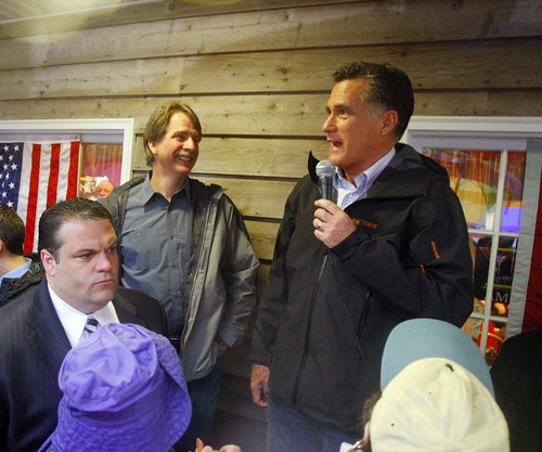 Republican presidential candidate, former Massachusetts Gov. Mitt Romney, accompanied by comedian Jeff Foxworthy speaks during a campaign stop at the Whistle Stop Cafe, Monday, March 12, 2012 in Mobile, Ala. (AP Photo/ John David Mercer)