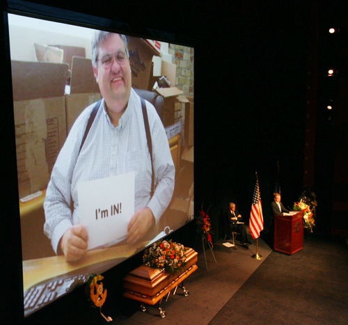 Steve Griffin  |  The Salt Lake Tribune  Photos of Todd Taylor are projected onto a large screen during funeral services Monday for the longtime former Democratic Party executive director. About 300 people turned out for the ceremony at the Rose Wagner Performing Arts Center in Salt Lake City.