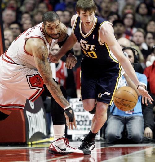 Utah Jazz forward Gordon Hayward (20) controls the ball as Chicago Bulls forward Carlos Boozer (5) guards during the first half of an NBA basketball game in Chicago, Saturday, March 10, 2012. (AP Photo/Nam Y. Huh)