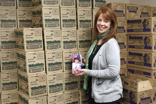 Courtesy of Annie Cutler CEO Cathleen Sparrow of the Girl Scouts of Utah, with a few of the thousands of boxes of cookies that girls are selling this year.