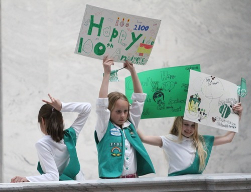Rick Egan  | The Salt Lake Tribune   Brianna Cooley, Fruit Heights, (center) and Taya Unruh, Woods Cross, (right) joined more than 1,500 Girl Scouts, their families, friends, showed up at the Capitol to celebrate the Girl Scouts' history by singing songs, performing a
