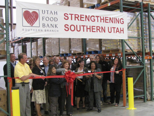 Mark Havnes | The Salt Lake Tribune Karen Sendelback, center, CEO of the Utah Food Bank, gets ready Wednesday  to snip a ribbon during the official opening ceremony of the Food Bank's southern Utah branch office in St. George.