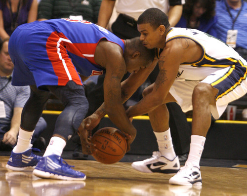 Rick Egan  | The Salt Lake Tribune   Detroit Pistons point guard Rodney Stuckey (3) and Utah Jazz point guard Earl Watson (11) battle for the ball, in NBA action,  Jazz vs. Detroit game, Monday, March 12, 2012.