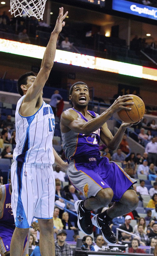 Phoenix Suns guard Ronnie Price (2) goes to the basket around New Orleans Hornets forward Gustavo Ayon (15) in the second half of an NBA basketball game in New Orleans,  Wednesday, Feb. 1, 2012. The Suns defeated the Hornets 120-103. (AP Photo/Bill Haber)