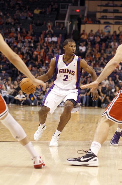 Phoenix Suns' Ronnie Price against the Milwaukee Bucks in an NBA basketball game Sunday, Jan. 8, 2012, in Phoenix. (AP Photo/Paul Connors)