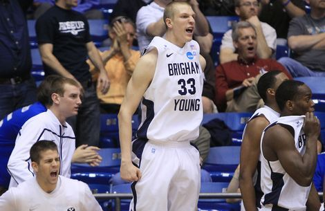Brigham Young forward Nate Austin (33) celebrates in front of the bench after BYU took the lead in the second half of an NCAA men's college basketball tournament opening-round game against Iona, Tuesday, March 13, 2012, in Dayton, Ohio. BYU won 78-72. (AP Photo/Al Behrman)