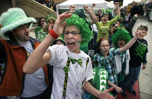 Scott Sommerdorf  |  Tribune file photo Jeff Johnson of West Valley City, center, and Jennifer Rhode of Magna, below, right, enjoy the 2011 St. Patrick's Day Parade. This year's parade begins 10 a.m. Saturday at The Gateway.
