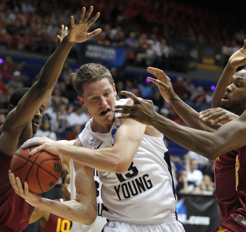 Brigham Young forward Brock Zylstra (13) pulls in a rebound in the first half of an NCAA men's college basketball tournament opening-round game against Iona, Tuesday, March 13, 2012, in Dayton, Ohio. (AP Photo/Skip Peterson)