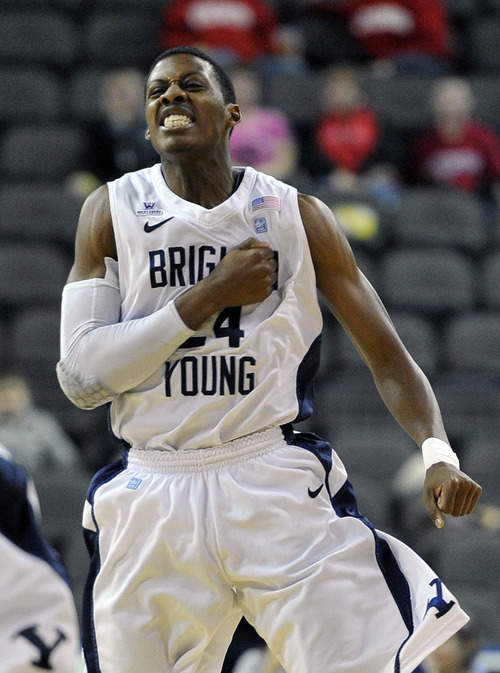 BYU's Damarcus Harrison (24) reacts after a basket against Wisconsin during the first half of an NCAA college basketball game on Saturday, Nov. 26, 2011, in Hoffman Estates, Ill. (AP Photo/Jim Prisching)