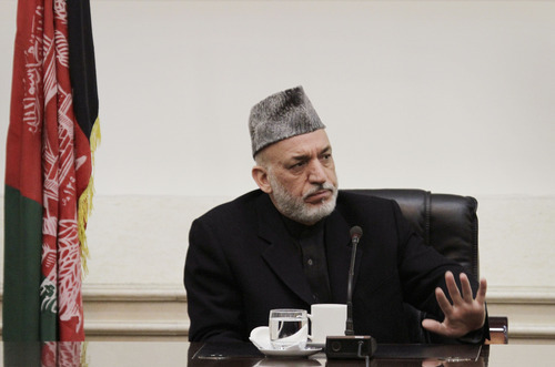 Afghan President Hamid Karzai listens to speeches of a family member,unseen, of Afghan civilians who were killed Sunday by a US soldier in Panjwai in Kandahar province at the presidential palace in Kabul, Afghanistan, Friday, March 16, 2012. Afghan President Hamid Karzai lashed out at the United States on Friday, saying he is at the