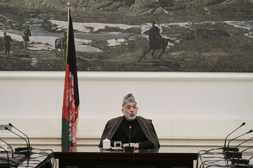 Afghan President Hamid Karzai speaks with the family members of Afghan civilians who were killed Sunday by a US soldier in Panjwai of Kandahar province at the presidential palace in Kabul, Afghanistan, Friday, March 16, 2012. Afghan President Hamid Karzai lashed out at the United States on Friday, saying he is at the