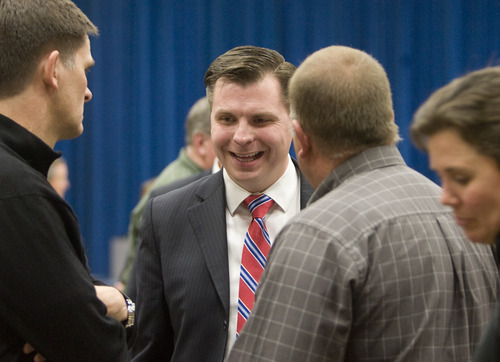 Kim Raff   The Salt Lake Tribune Dan Liljenquist talks with people at the Republican caucuses at Mueller Park Jr. High in Bountiful on Thursday.