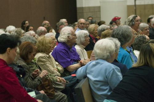Chris Detrick     The Salt Lake Tribune Registered Republican voters listen during the Republican caucuses at Washington Elementary School on Thursday.