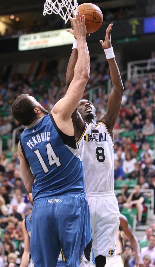 Paul Fraughton   The Salt Lake Tribune. Utah's Josh Howard goes up for the shot against Minnesota's Nikola Pekovic.  Thursday, March 15, 2012