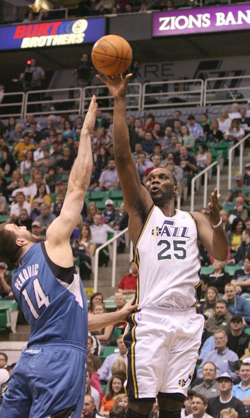 Paul Fraughton   The Salt Lake Tribune. Utah's Al Jefferson  takes the shot over the outstretched arm of Minnesota's Nikola Pekovic. The Utah Jazz played the Minnesota Timberwolves at Energy Solutions Arena.  Thursday, March 15, 2012