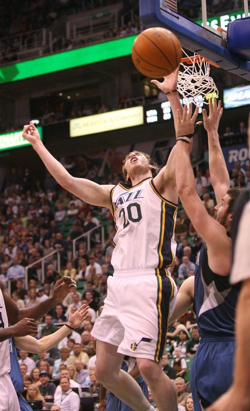 Paul Fraughton   The Salt Lake Tribune. Utah's Gordon Hayward is fouled as he goes to the basket by Minnesota's Kevin Love.  The Utah Jazz played the Minnesota Timberwolves at Energy Solutions Arena.  Thursday, March 15, 2012