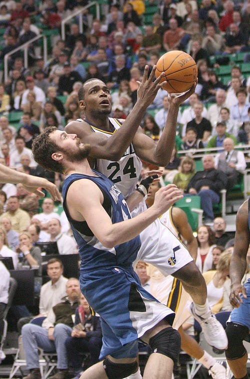 Paul Fraughton   The Salt Lake Tribune. Paul Millsap drives to the basket  as Minnesota's Kevin Love defends.The Utah Jazz played the Minnesota Timberwolves at Energy Solutions Arena.  Thursday, March 15, 2012