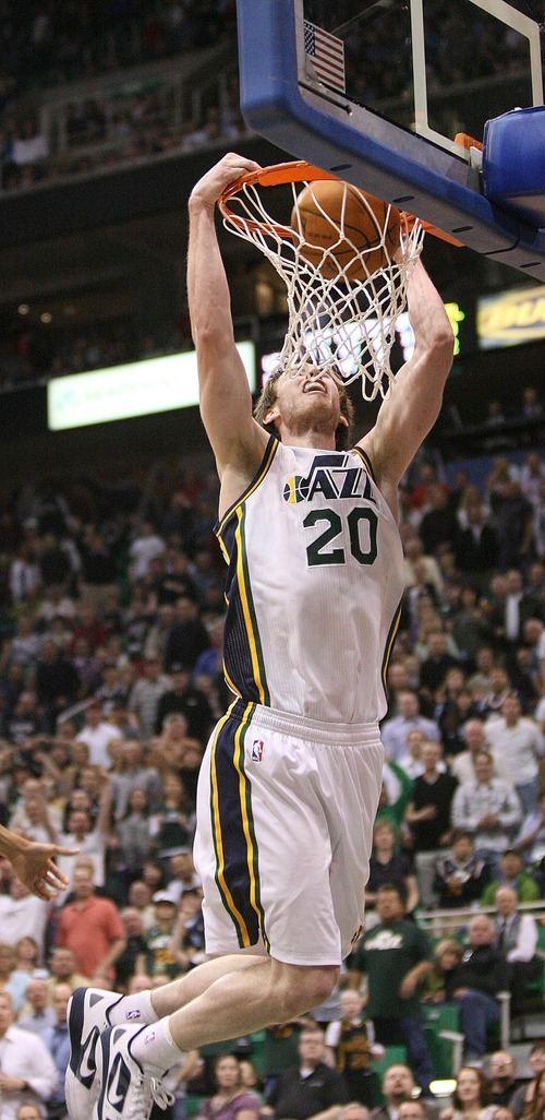 Paul Fraughton   The Salt Lake Tribune. Gordon Hayward throws down a slam dunk in the overtime period.The Utah Jazz played the Minnesota Timberwolves at Energy Solutions Arena.  Thursday, March 15, 2012