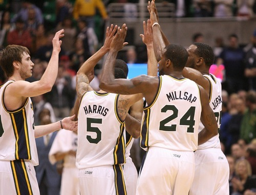 Paul Fraughton   The Salt Lake Tribune. As the clock winds down in the overtime  period, Jazz players give each other high fives as the Jazz defeated the Timberwolves  111 to 105. The Utah Jazz played the Minnesota Timberwolves at Energy Solutions Arena.  Thursday, March 15, 2012