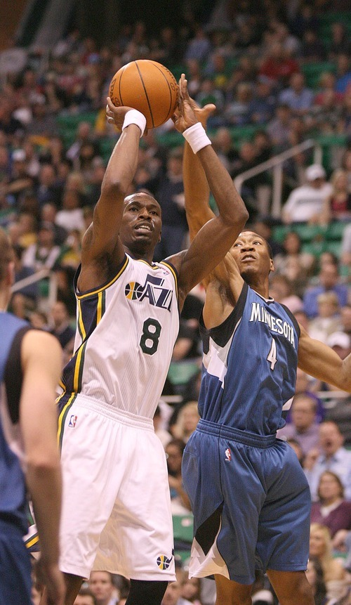 Paul Fraughton   The Salt Lake Tribune. Utah's Josh Howard is blocked from behind by Minnesota's Wesley Johnson. The Utah Jazz played the Minnesota Timberwolves at Energy Solutions Arena.  Thursday, March 15, 2012