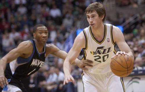 Jeremy Harmon  |  The Salt Lake Tribune  Utah's Gordon Hayward is defended by Minnesota's Wes Johnson as the Jazz host the Timberwolves at EnergySolutions Arena Saturday, Jan. 21, 2012 in Salt Lake City.