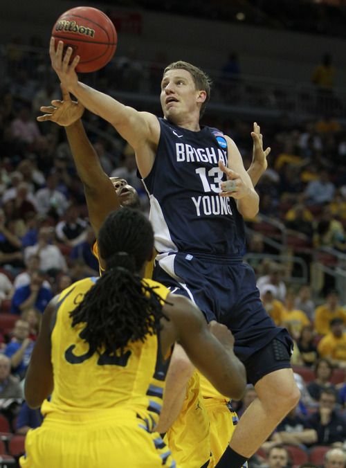 BYU guard/forward Brock Zylstra (13) shoots over the defense of Marquette forward Jae Crowder (32) in the first half of their NCAA tournament second-round college basketball game in Louisville, Ky., Thursday, March 15, 2012. (AP Photo/John Bazemore)