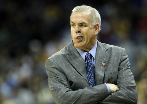 BYU head coach Dave Rose reacts in the first half of their NCAA tournament second-round college basketball game against Marquette in Louisville, Ky., Thursday, March 15, 2012. (AP Photo/Dave Martin)