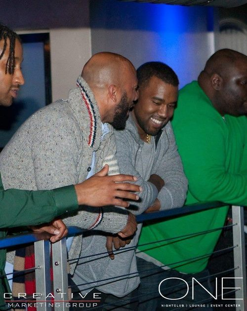 Rapper Common (turned up collar) speaks to Kanye West at nightclub One on March 16, 2012, in Salt Lake City. It was Common's 40th birthday party. Photo courtesy Konstantine Deslis.