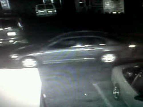 Courtesy photo  Investigators believe this vehicle, possibly a dark blue Honda, 2001-2003, is the one in which a suspect returned to C.J. Smoke Shop in Salt Lake City, where store employee Stephen Guadalupe Chavez was shot and killed on Wednesday. Police say the vehicle most likely belongs to the driver, not the shooter.