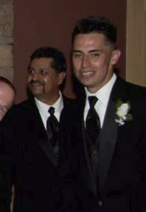 Stephen Chavez, pictured, right, poses with his father, Isabel Chavez. Courtesy of family.