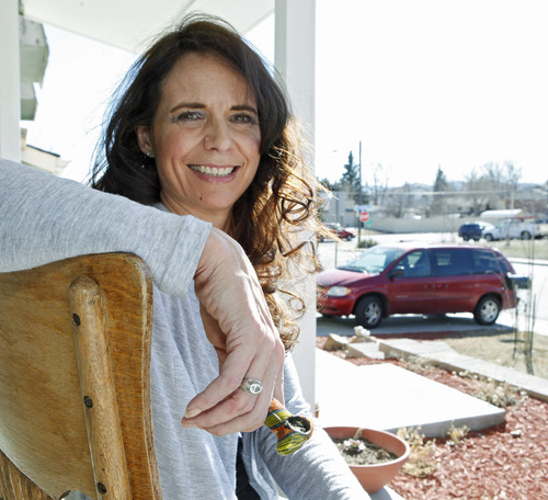 In this photo taken on Tuesday, March 6, 2012, Angeline Chilton a suburban Denver woman with multiple sclerosis who smokes pot twice a day to ease tremors, holds her pipe as she sits on the front porch of her home in Lakewood, Colo.  Chilton insists that she never drives high, but she fears that officials will rush to set an unproven blood-level standard that would put her at risk of breaking the law. In Colorado and Washington, the debate over how to tell whether a driver is high is more than academic. The states are struggling to come up with a blood-level standard for marijuana that would be analogous to the blood-alcohol standard used to decide who's driving drunk. (AP Photo/Ed Andrieski)