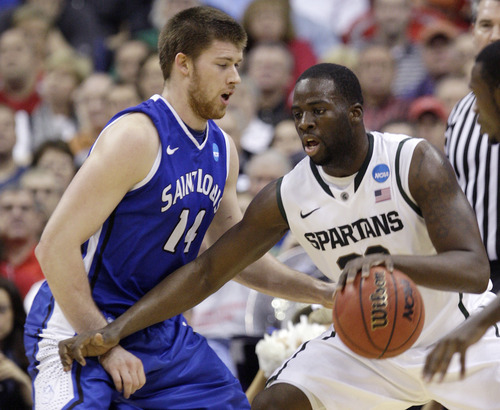 Michigan State's Draymond Green, right, posts up against Saint Louis' Brian Conklin during the first half of an NCAA college basketball tournament third-round game Sunday, March 18, 2012, in Columbus, Ohio. (AP Photo/Jay LaPrete)