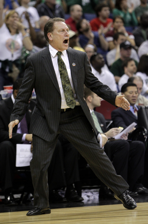 Michigan State head coach Tom Izzo yells to his team during the first half of an NCAA men's college basketball tournament third-round game against Saint Louis in Columbus, Ohio, Sunday, March 18, 2012. (AP Photo/Jay LaPrete)