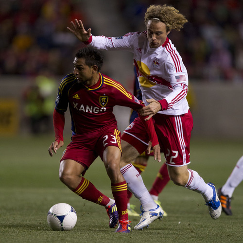 Trent Nelson  |  The Salt Lake Tribune Real Salt Lake's Paulo Junior (23) defended by New York's Stephen Keel. Real Salt Lake vs. New York Red Bulls, MLS Soccer Saturday, March 17, 2012 at Rio Tinto Stadium in Sandy, Utah.