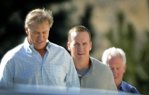 NFL football quarterback Peyton Manning, center, takes a tour earlier this month with executive vice president of football operations for the Denver Broncos John Elway, left,  and Broncos coach John Fox, rear right,  at the Broncos' training facility in Englewood, Colo.  (AP Photo/The Denver Post, John Leyba)