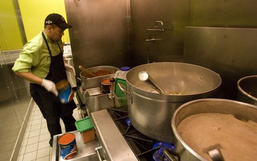 Leah Hogsten  |  The Salt Lake Tribune  Juan Valadez, Taste of Red Iguana's lead cook, mixes up enchilada sauce and chili verde in the City Creek food court. Taste of Red Iguana is one of eight Utah-based eateries that will compete for City Creek dining dollars, with more than a dozen national chains, including as The Cheesecake Factory and Texas de Brazil Churrascaria.