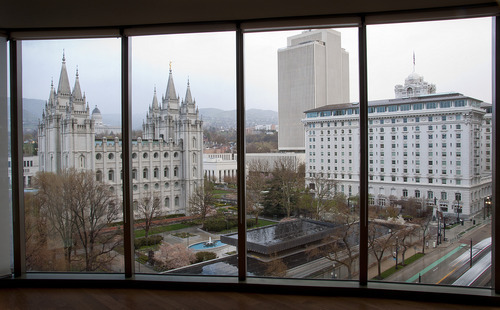 Michael Mangum  |  The Salt Lake Tribune The LDS Salt Lake Temple is shown through the window of a ninth-floor condo at the City Creek development.