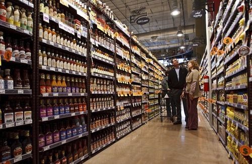 Leah Hogsten  |  The Salt Lake Tribune Stephanie Jordan and Randy Frisk, vendors from Sacramento, Calif., peruse the BBQ sauce aisle. The new Harmons grocery opened Wednesday in downtown Salt Lake City. The store at 100 S. 135 East was built on two levels. A 50,000-square-foot ground level features a large produce department and meat counter with fresh fish. On the 18,000-square-foot mezzanine there is a deli with a seating capacity for about 300 customers.