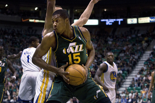 Scott Sommerdorf  |  The Salt Lake Tribune              Utah center Derrick Favors spims around Golden State's Andris Biedrins as the Utah Jazz play the Golden State Warriors early i n the first period at Energy Solutions Arena, Saturday, March 17, 2012.
