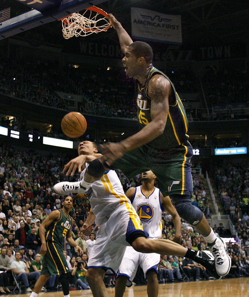 Scott Sommerdorf  |  The Salt Lake Tribune              Derrick Favors made this dunk in overtime to make the score 93-87 and keep the Jazz momentum going in the extra session. The Utah Jazz defeated the Golden State Warriors 99-92 in OT at Energy Solutions Arena, Saturday, March 17, 2012.