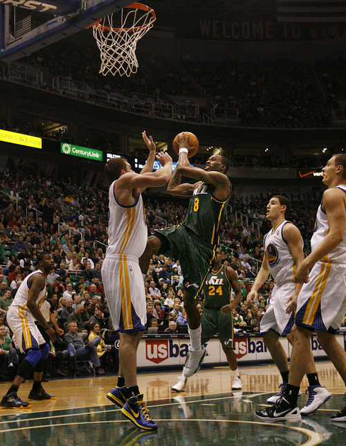 Scott Sommerdorf  |  The Salt Lake Tribune              Jazz forward Josh Howard drives as the Utah Jazz play the Golden State Warriors early in the first period at Energy Solutions Arena, Saturday, March 17, 2012.