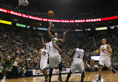 Scott Sommerdorf  |  The Salt Lake Tribune              Utah guard Devin Harris drives as the Utah Jazz play the Golden State Warriors early in the first period at Energy Solutions Arena, Saturday, March 17, 2012.
