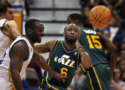 Scott Sommerdorf  |  The Salt Lake Tribune              Jamaal Tinsley of the Jazz scrambles for this loose ball  during fourth quarter play. The Utah Jazz defeated the Golden State Warriors 99-92 in OT at Energy Solutions Arena, Saturday, March 17, 2012.