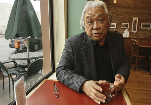 FILE - In this file photo taken Jan. 20, 2011, Glenn Nishimura discusses his health insurance situation at a coffee shop in Little Rock, Ark. As the U.S. Supreme Court prepares to hear arguments on President Barack Obama's health care overhaul, The Associated Press spoke with a variety of people to hear their experiences so far with the landmark legislation, whose major provisions don't take effect until 2014. Reporters asked: How has the health care law affected your life? Nishimura has been uninsured for nearly three years. He lost his health coverage after he left a full-time position with benefits in 2007, thinking he could land another good job. The recession destroyed that plan. He's been denied coverage because of high blood pressure and high blood-sugar levels. A provision in the national health care law gave his state $46 million to insure people like him who've been denied coverage because of pre-existing conditions. But Nishimura said he can't afford the coverage. It would cost him about $6,300 a year in premiums with a $1,000 deductible, meaning he would pay the first $1,000 out of his own pocket before coverage kicks in. (AP Photo/Danny Johnston, File)
